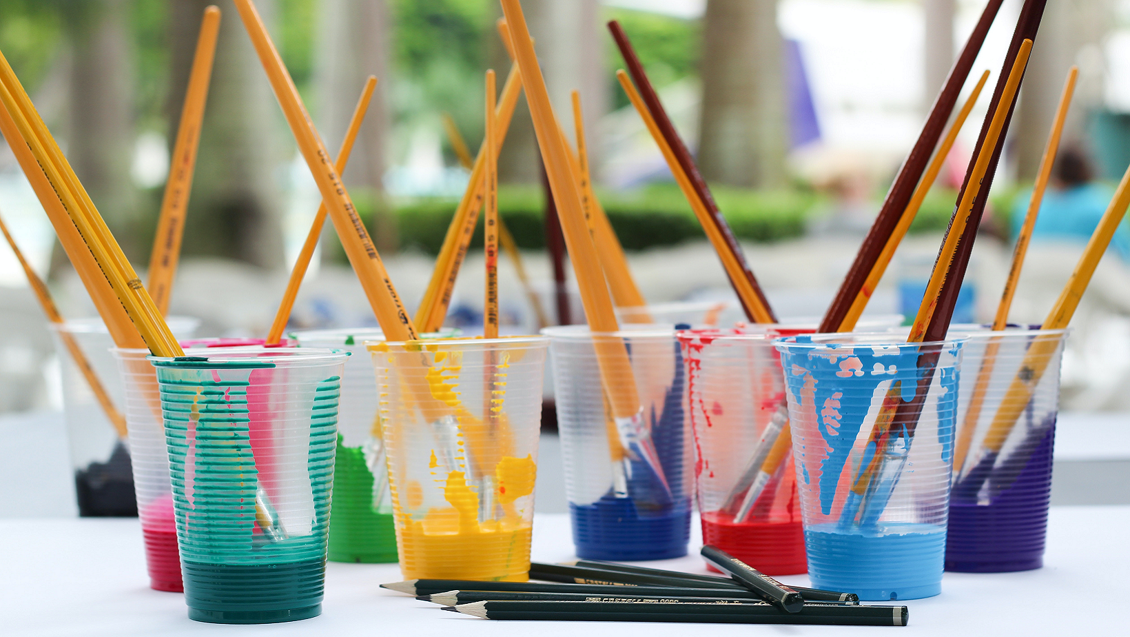 Brushes In Paint Plastic Cups